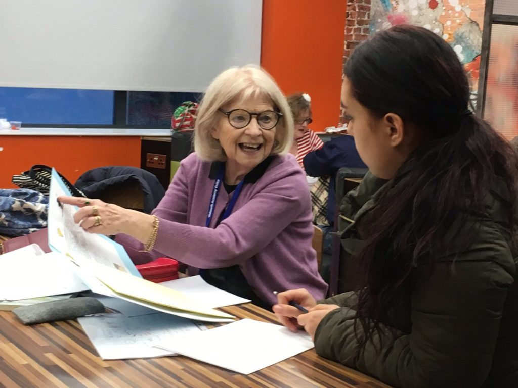 One of our peer supporters training a volunteer